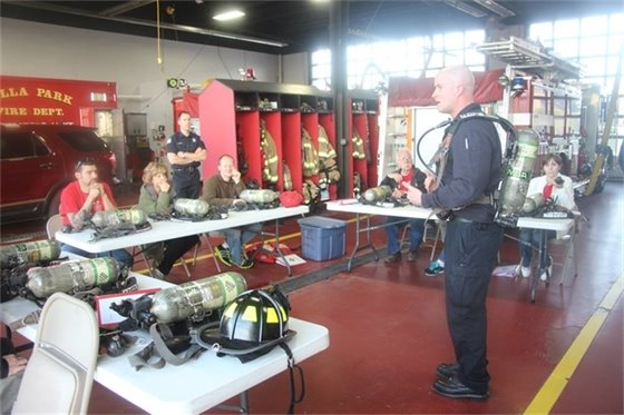 Villa Park Citizens Fire Academy participants learn how to use self-contained breathing apparatus (SCBA).