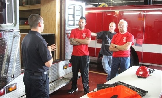 Villa Park Citizens Fire Academy participants learn about fire investigation.