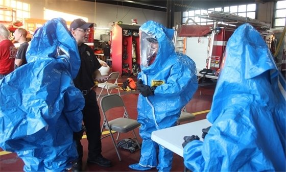 Villa Park Citizens Fire Academy participants try on hazmat gear.