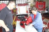 Villa Park Citizens Fire Academy participants tested gloves used in ice rescue.