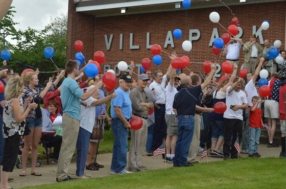 Villa Park residents and officials release balloons at the Villa Park VFW on Memorial Day 2015