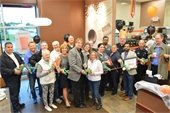 Village officials and member of the Villa Park Chamber of Commerce welcome Dunkin' Donuts to North Avenue.