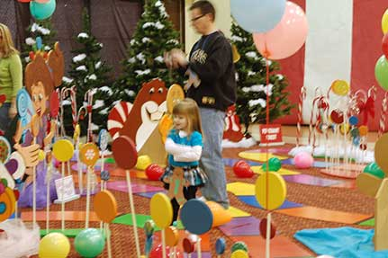 Children on Life-Sized Candy Land Board