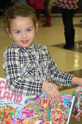 Little Girl Holding Copy of Candy Land Board Game