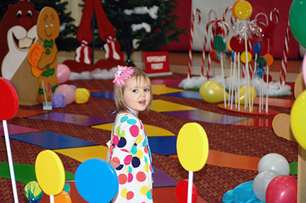Little Girl Playing the Candy Land Life-Sized Game