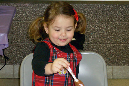 Little Girl with Chocolate Covered Spoon