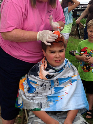 Child getting hair dyed
