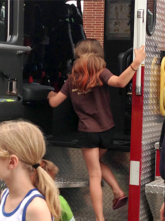 Little Girl Climbing into the Fire Truck