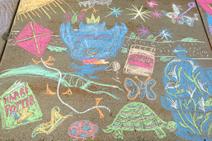 Several Colorful Doodles on the sidewalk