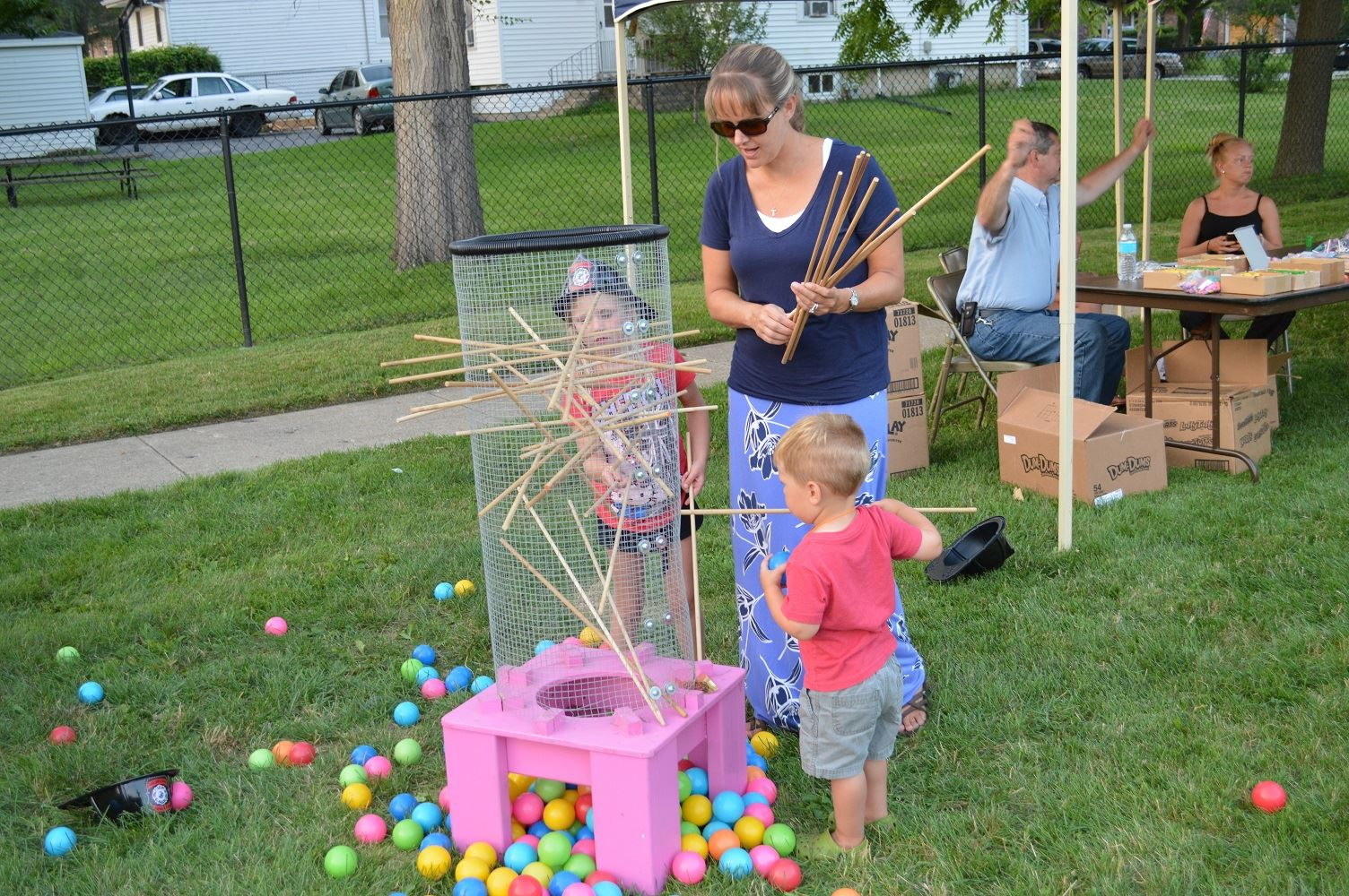Community members play life-sized Kerplunk at a National Night Out event at the Iowa Community Center, Aug. 2.