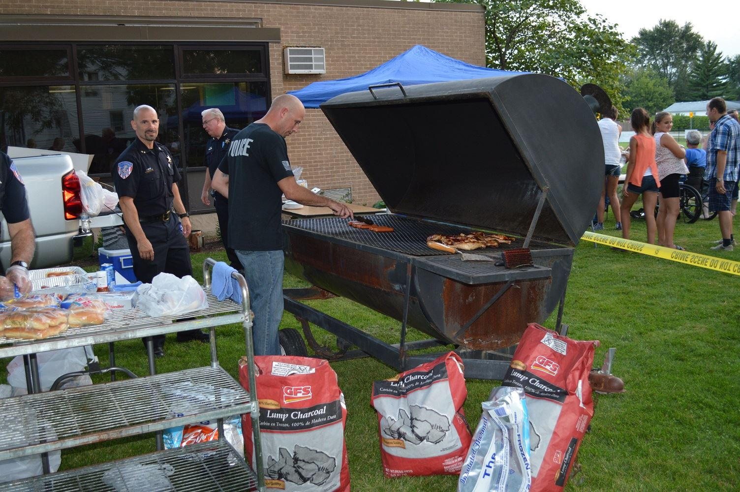 Villa Park Detective Hruby grills up food for community members at a National Night Out event at the Iowa Community Center, Aug. 2.