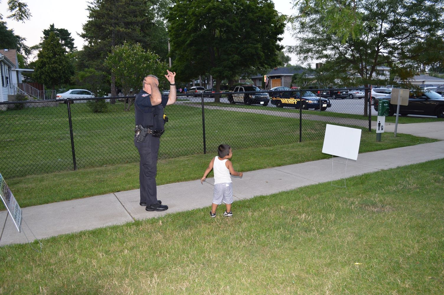 A Villa Park Police Officer plays with a young boy at a National Night Out event at the Iowa Community Center, Aug. 2.