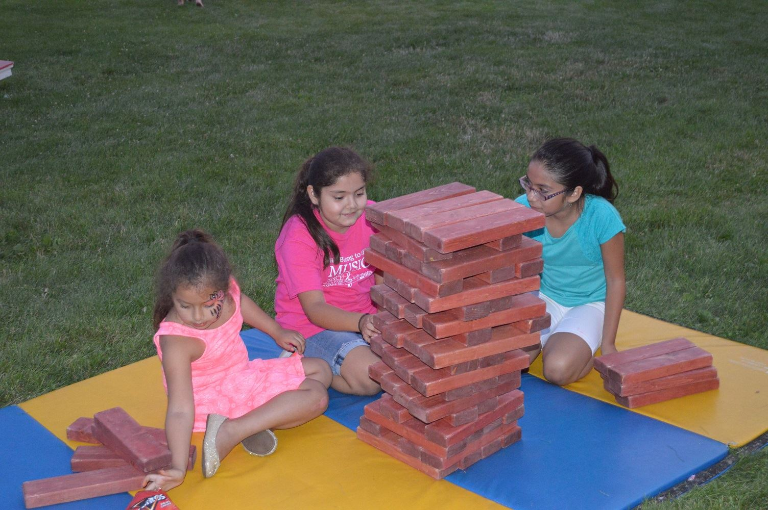 Children play life-sized Jenga at Villa Park's National Night Out event at the Iowa Community Center Aug. 2, 2016.
