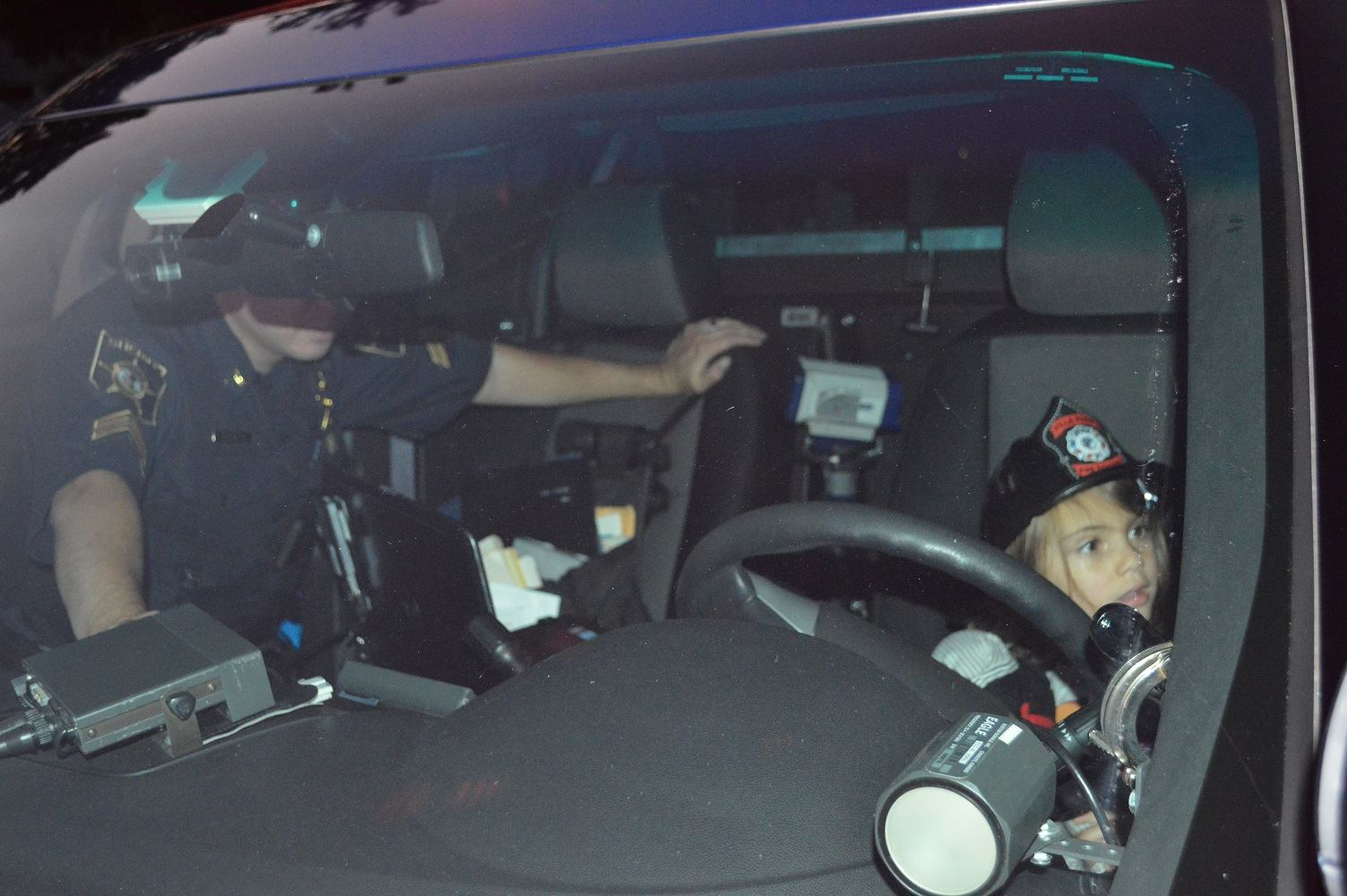 Children take turns checking out the view from the driver's seat of a DuPage County Sheriff's vehicle during a National Night Out event at the Iowa Community Center, Aug. 2.