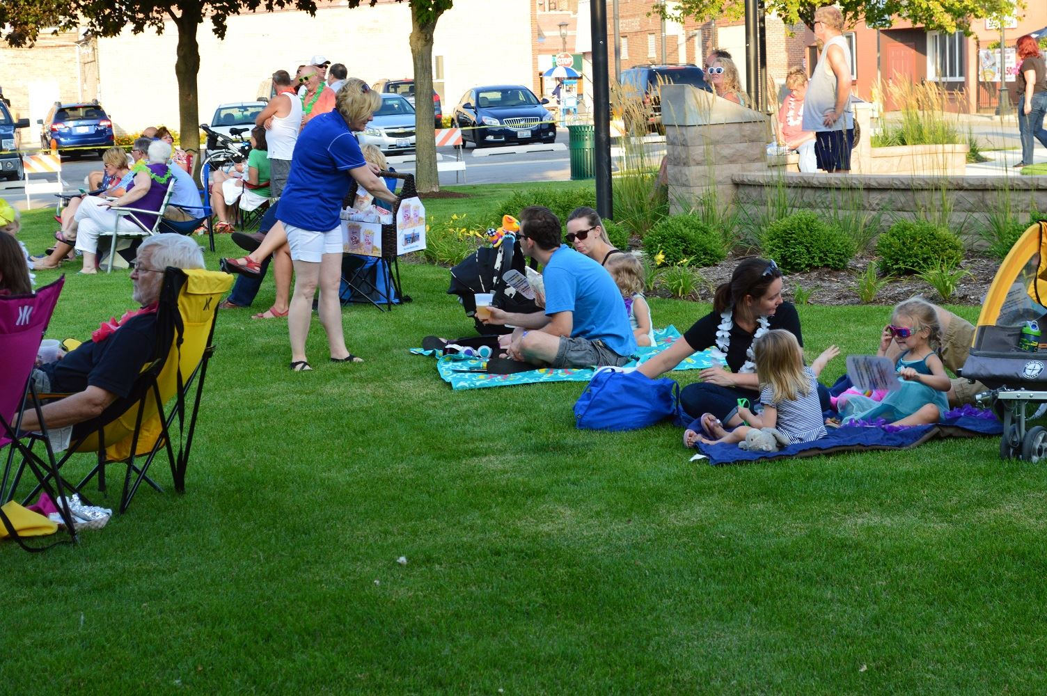 Community members sit on blankets and chairs at Cortesi Veterans Memorial Park to watch Mr. Meyers band perform Aug. 4, 2016.