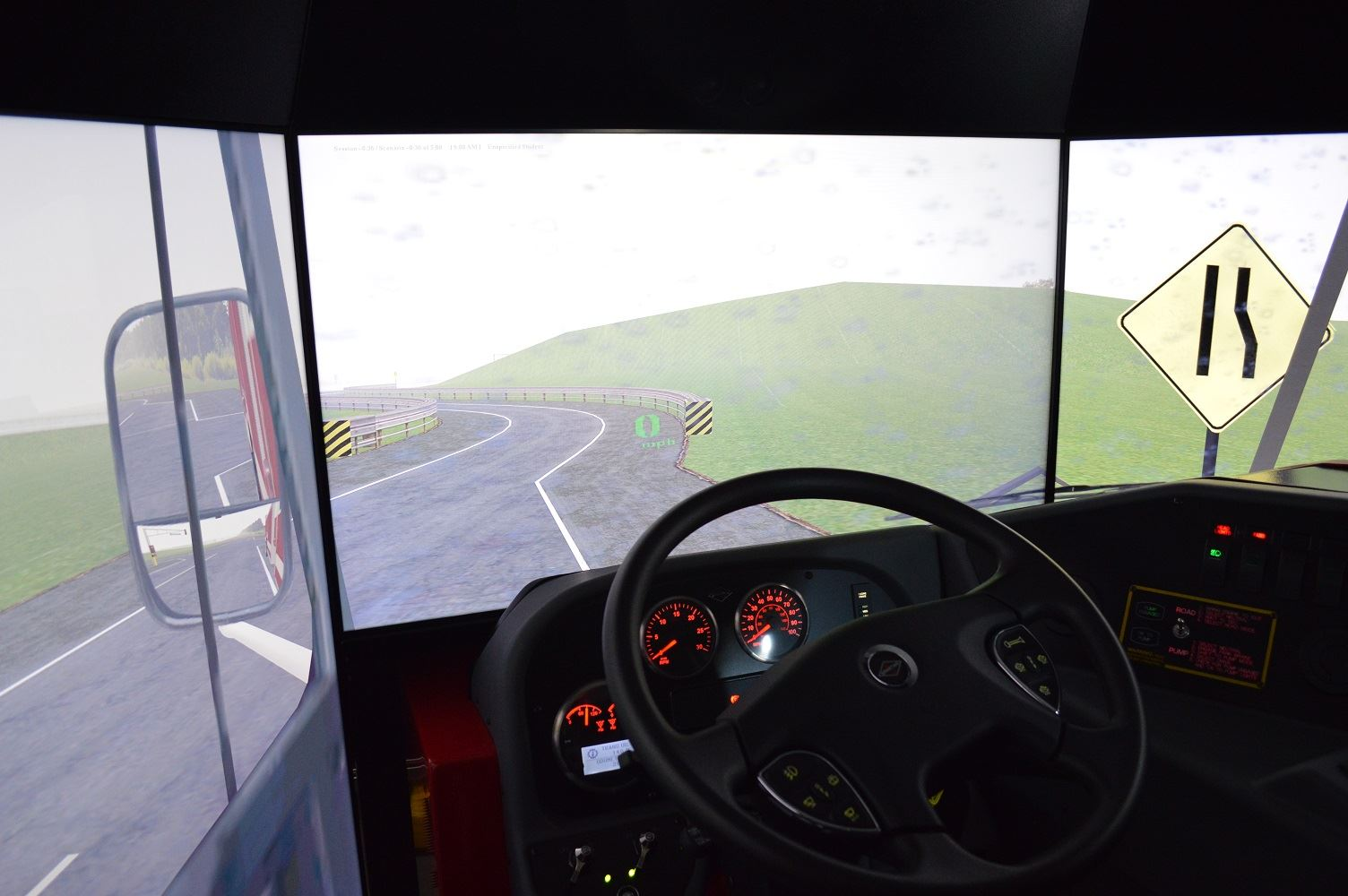 The driver's seat of the regional driving simulator is surrounded by screens used to project roadway scenarios.